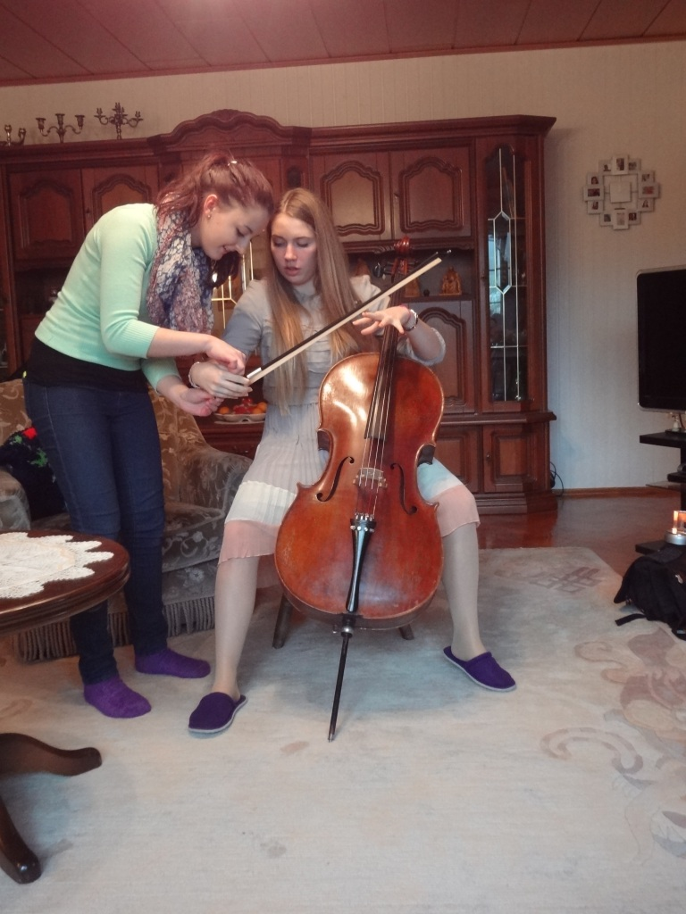 My dear friend teaching me to play the Cello.
