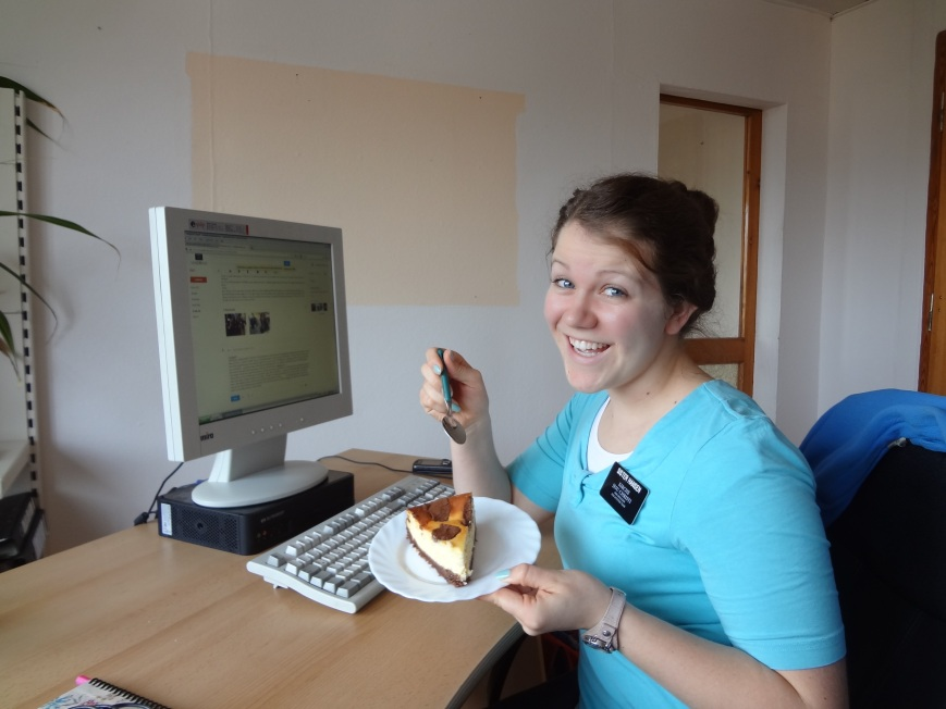 A photo of us doing emails...eating cake?! Yea, the adorable ladies brought us cake to fatten us up.